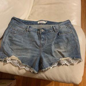 Torrid Premium denim shorts with lace pockets.
